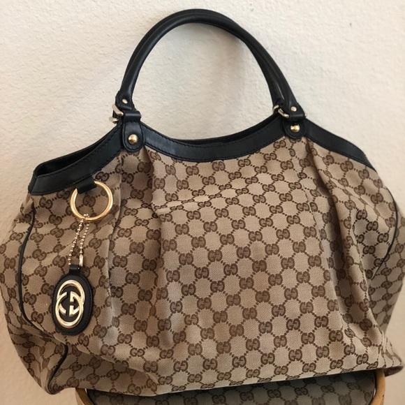 Gucci Handbags - Gucci 100% authentic bag w/ duster